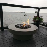 rustic-round-waterfront-firepit
